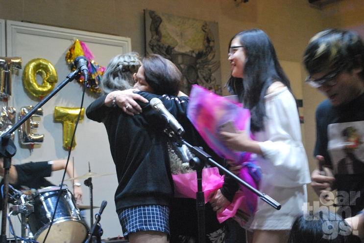Reese is flanked by her mother and sister as she wrapped up her set... although there was one more song to go.